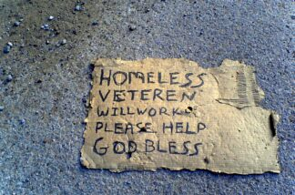 photo of a homeless person's cardboard begging sign