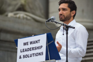 photo of a speaker at a Vancouver affordable housing protest