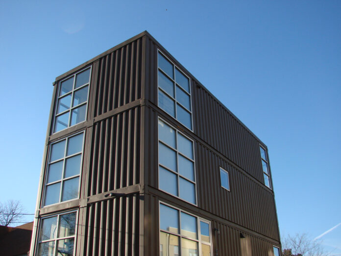 photo of several-story house built from shipping containers