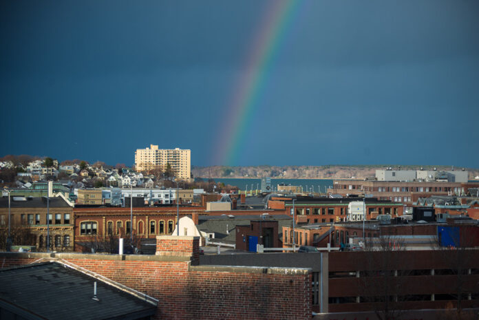 photo of a rainbow over a cityscape