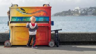 image of boy playing piano