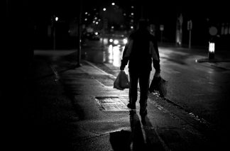 silhouette of person carrying groceries at night