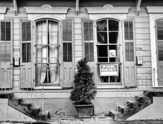 Image of home with for rent sign in the window