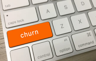 image of computer keyboard with key marked churn