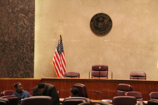 Image of podium and flag in Chicago's Council Chamber