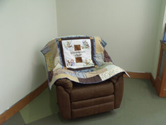 lazy boy chair with handmaide quilt
