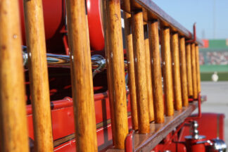 Image of wooden rungs on a ladder attached to a fire truck