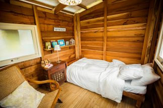 image of wood panelled bedroom