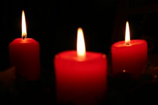 image of three lighted red candles