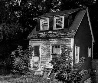 black and white image of abandonned tiny house
