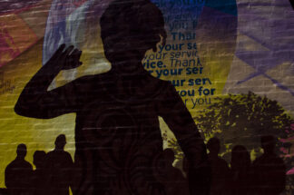 image of shadow figures and words painted on the side of homeless shelter for veterans in delaware