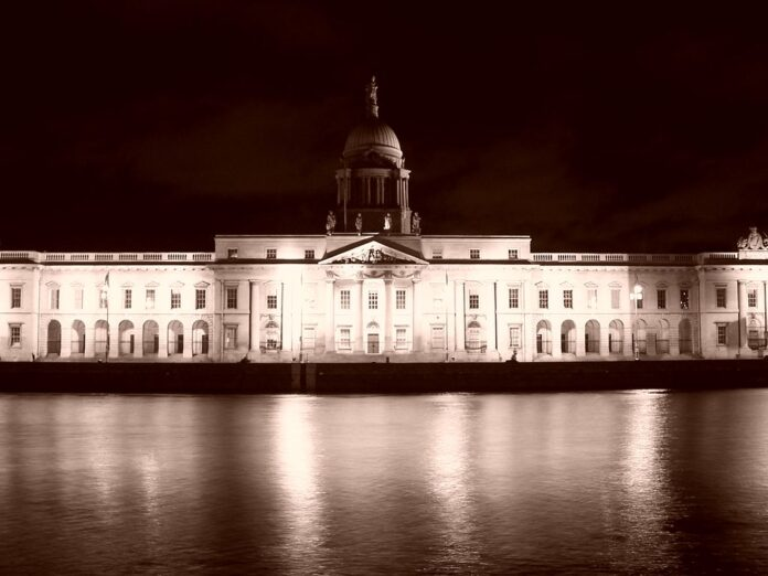 A night time shot of the Custom House in Dublin, viewed across the River Liffey