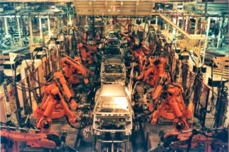 robots building automobiles on an assembly line
