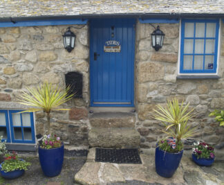 stone cottage with blue door