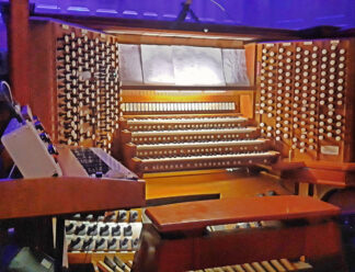 image of organ with foot pedals, consoles and stops
