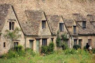 Attached cottages in the Cotswolds, England, originally constructed in the 14th century