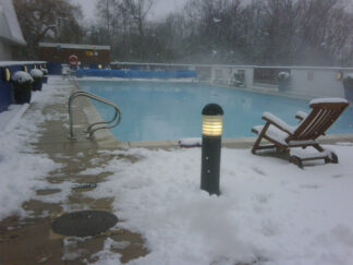 snow scene with warm outdoor pool