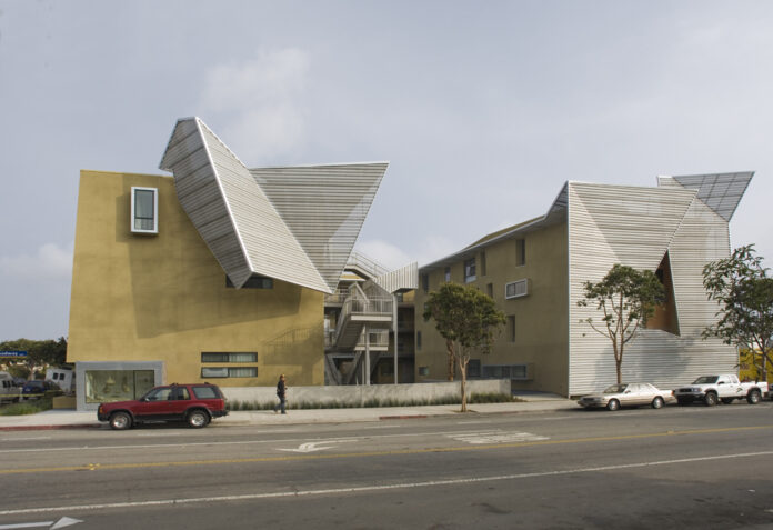 affordable housing complex with flared roof features