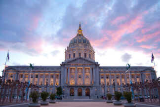 San Francisco City Hall, framed by pink clouds