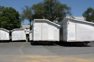 manufactured homes covered in white plastic end on view
