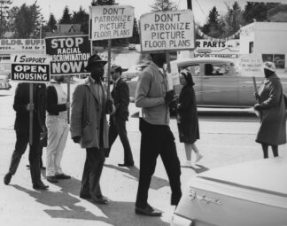 protesters walking and holding signs