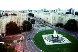 view of Karl Marx allee in Berlin with operating fountain in roundabout
