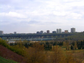 bird's eye view of Edmonton with river in foreground and apartment buildings on the skyline