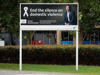 bill board which reads end domestic violence