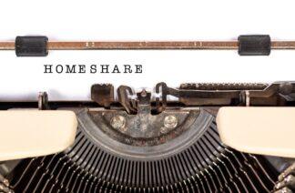 manual typewriter bearing the typed word HOMESHARE