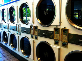 a two storey row of clothes dryers