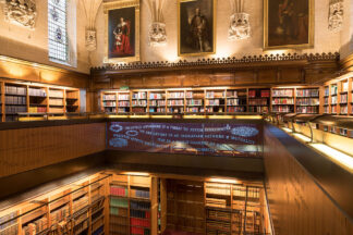 library of the UK supreme court with the inscription Injustice anywhere is a threat to justice everywhere. We are caught in an inescapable netwok of mutuality, tied in a single garment of destiny. Whatever affects one directly affects us all indirectly.