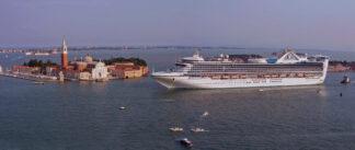 cruise ship dwarfs island in Venice
