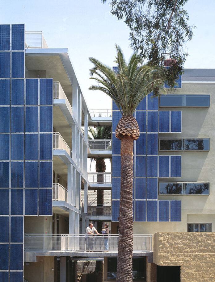 solar panels and entrance to LEED certified affordable housing