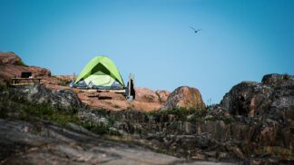 dome tent perched on platform set on rocks
