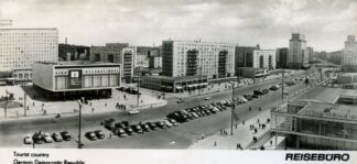 black and white soviet era post card showing the Karl Marx Allee in Berlin