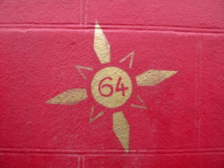 gold stencil of 64 with embellishments on a red background