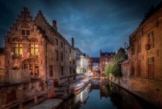 night time scene of narrow canal in Bruges