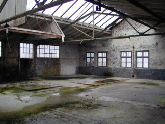 empty factory building with extensive skylighting