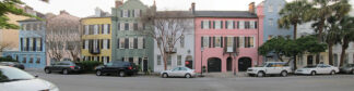 townhouses painted in muted rainbow colours