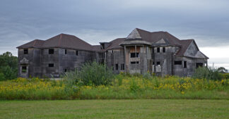 An abandoned, though fairly recent McMansion, looking as if it were a hundred years old