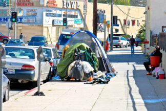 a homeless person's tent set up on a los angeles sidewalk