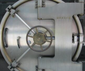 A large circular bank safe door