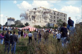 Dust flies as the Elizabeth St. Flats in Glasgow are demolished by explosion in 1993