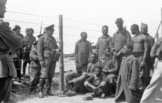 Black prisoners in a camp in Eastern Europe