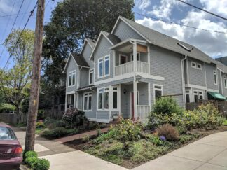 grey and white trimmed duplexes in tradition housing style