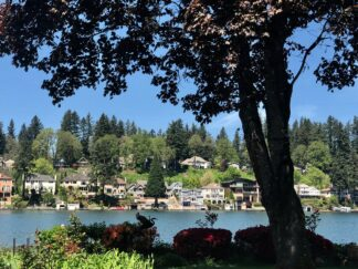 A view across Lake Oswego in Oregon, showing upscale houses on the far shore