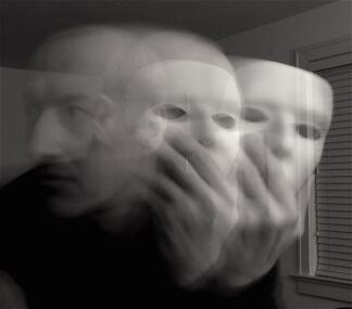 blurry image of two masks and a face