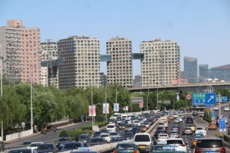 Highways in the foreground, high rises in the background view of Beijing, China