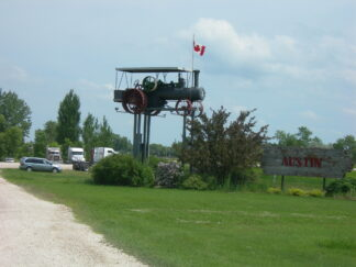 a tractor high on a pedestal in Austin, Manitoba