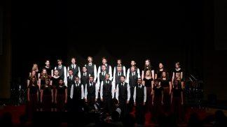 A choir of men, women and children